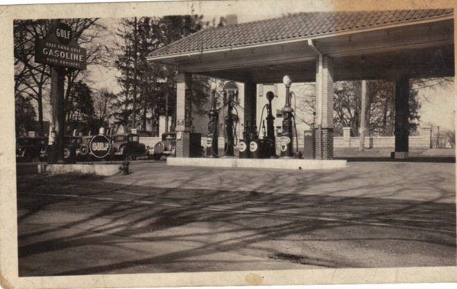 "Late 1920's. In front is a large sign that reads ""That Good Gulf"