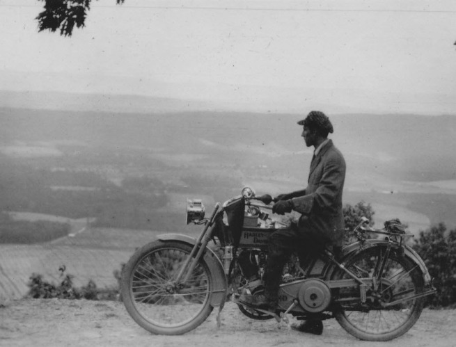 Lewis Reed sitting on his Harley Davidson motorcycle circa 1915 somewhere outside Frederick MD