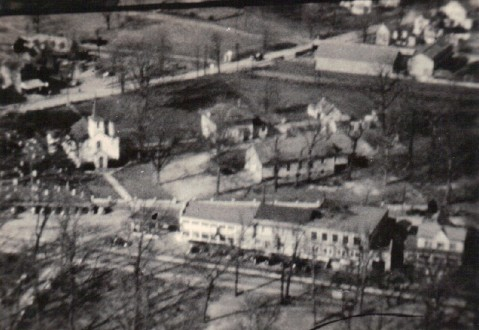 1920s – Original Reed Brothers facility with St Mary's Church and Cemetery at upper portion of photo