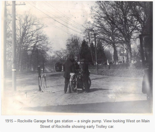 1915 – Rockville Garage first gas station – a single pump. View looking West on Main Street of Rockville showing early Trolley car.