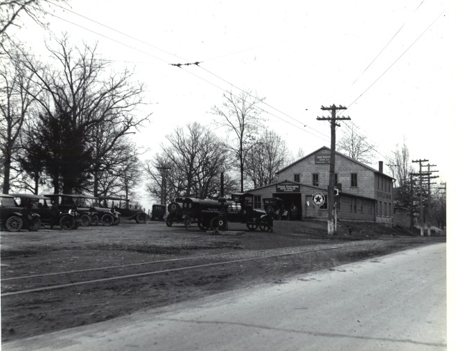1917 Original Rockville Garage with 2 story addition. Note the Texaco Filling Station signage and the Texaco Petroleum fuel truck refilling the single pump in front.