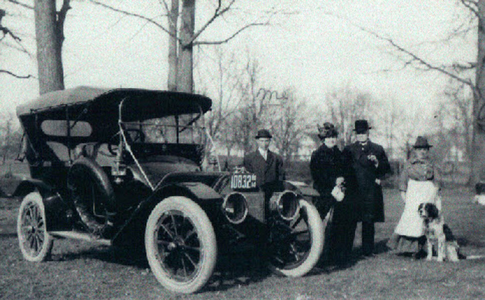Lewis reed left as chauffeur with unidentified family circa 1914