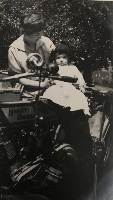 Lady & toddler on Harley Davidson motorcycle